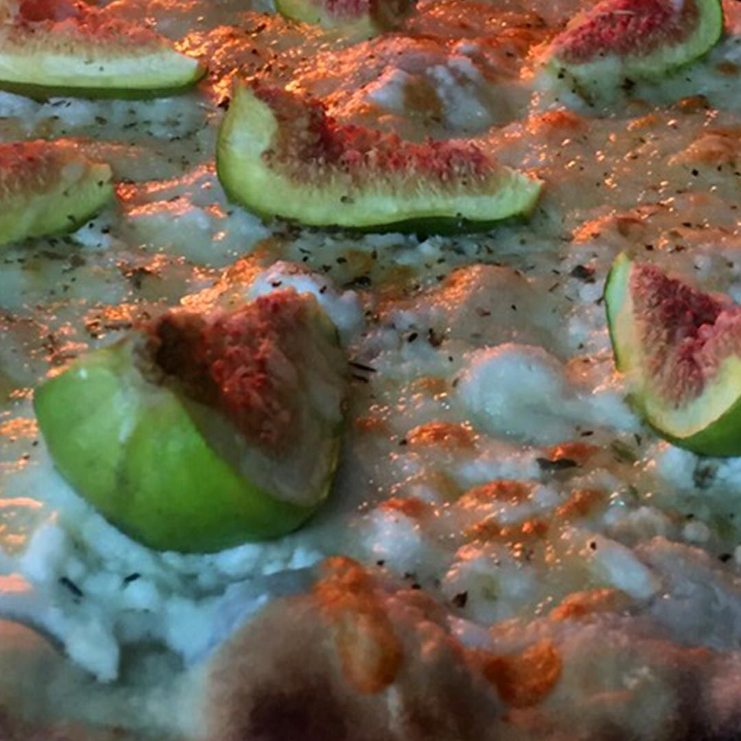 Honey Goat Fig Pizza w/ Crème Fresh Spread............Mozzarella Cheese, Goat Cheese, Fig, Honey & Black olives