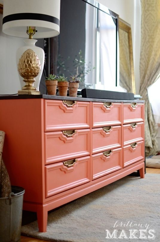 coral dresser as tv stand. lots of amazing storage! I would love to even paint my bedroom dresser this color! #home #decor