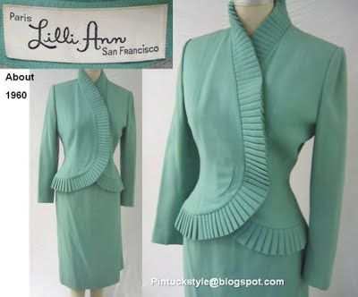 In this creamy aqua crepe suit from about 1960, a variation in small pleating is used to frame the face with drama. The use of an asymmetrical front is seen. Lilli Ann would use this popular design devise often during this era.