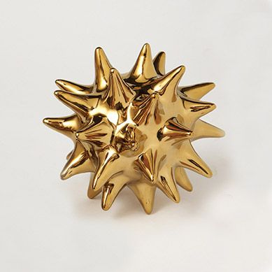 Large Gold Urchin Object is part of Gold Home Accessories Life - DESCRIPTION This dynamic starburst sculpture by Dwell Studios modeled after an urchin will add a burst to any space  A modern object that is sure to wow as a decorative object in your home or as an affordable and unforgettable gift    FINISH Ceramic with gold finish