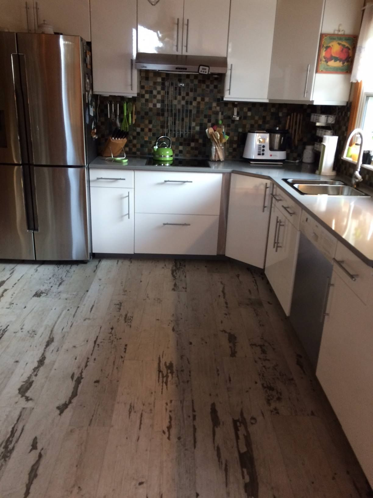 A distressed vinyl perfect for a kitchen vinyl flooring reclaimed distressed