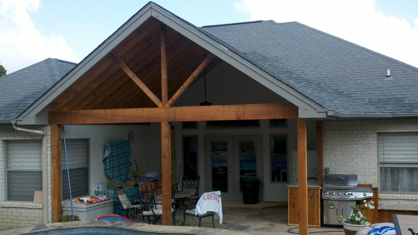 Covered Porch With Outdoor Kitchen Porch Addition House Roof Patio Addition