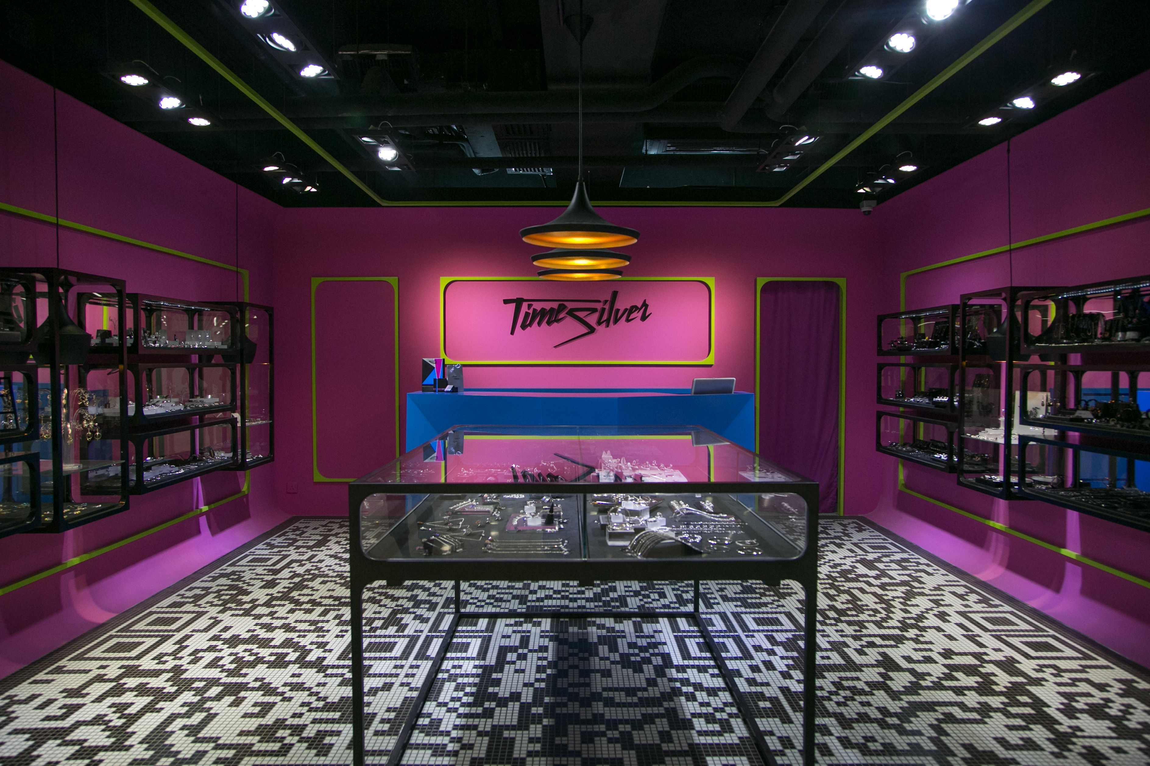 Time Silver jewelry store in Tsuen Wan, Hong Kong by Liquid Interiors - retail interior design, QR codes tiles, pink and blue, jewelry display, pop art