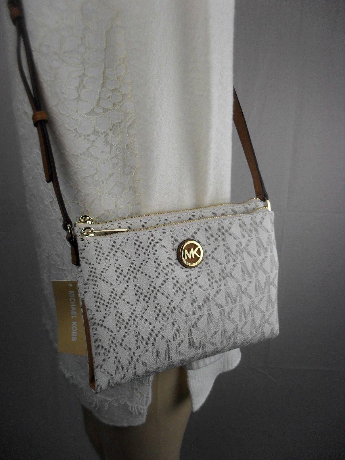 984636f48bd9 NWT Michael Kors Vanilla Fulton Large EW Crossbody PVC Handbag MK Messenger  Bag