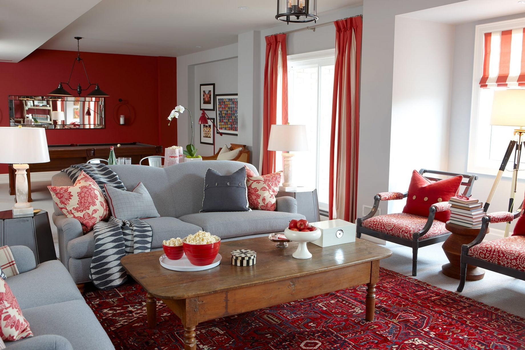 Front View Of Rec Room Showing Grey Sofa With Cozy Pillows And Big Red Rug Maroon Living Room Living Room Red Living Room Grey