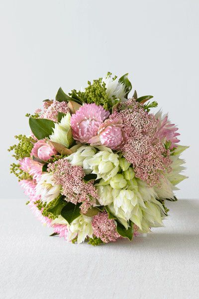 Clustered Posy Of Paper Daisy Blushing Bride And Mixed Buds Available In Autumn Pink BouquetWedding
