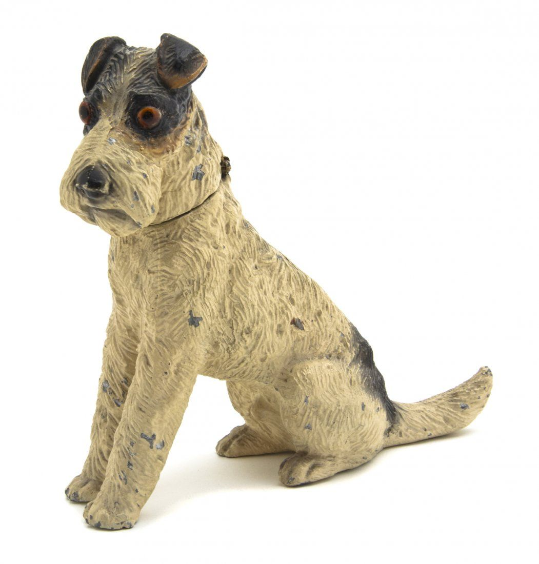 A Cast Metal Inkwell,  in the form of a seated dog, having glass inset eyes and polychrome decoration throughout.