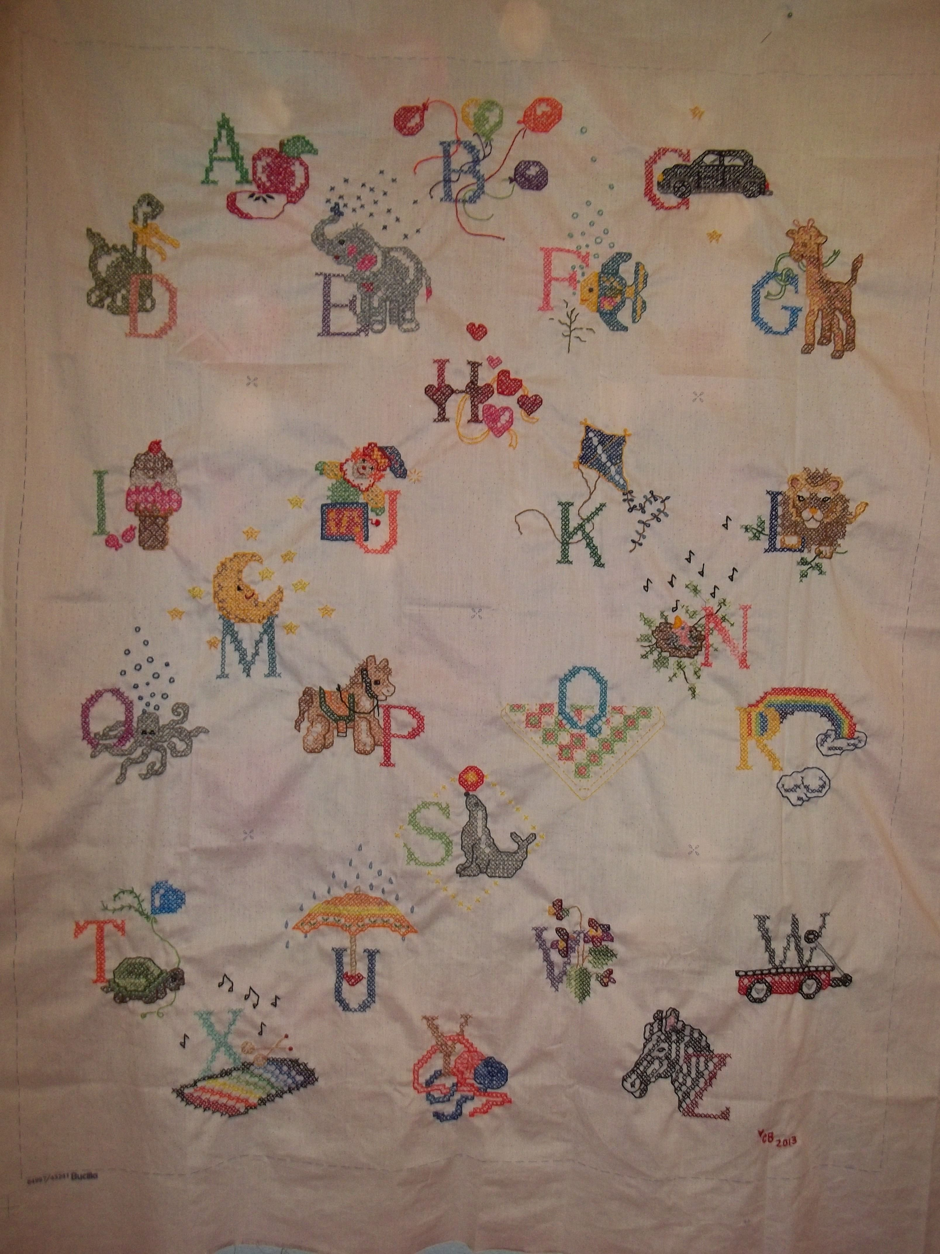 Embroidering the alphabet for a baby quilt