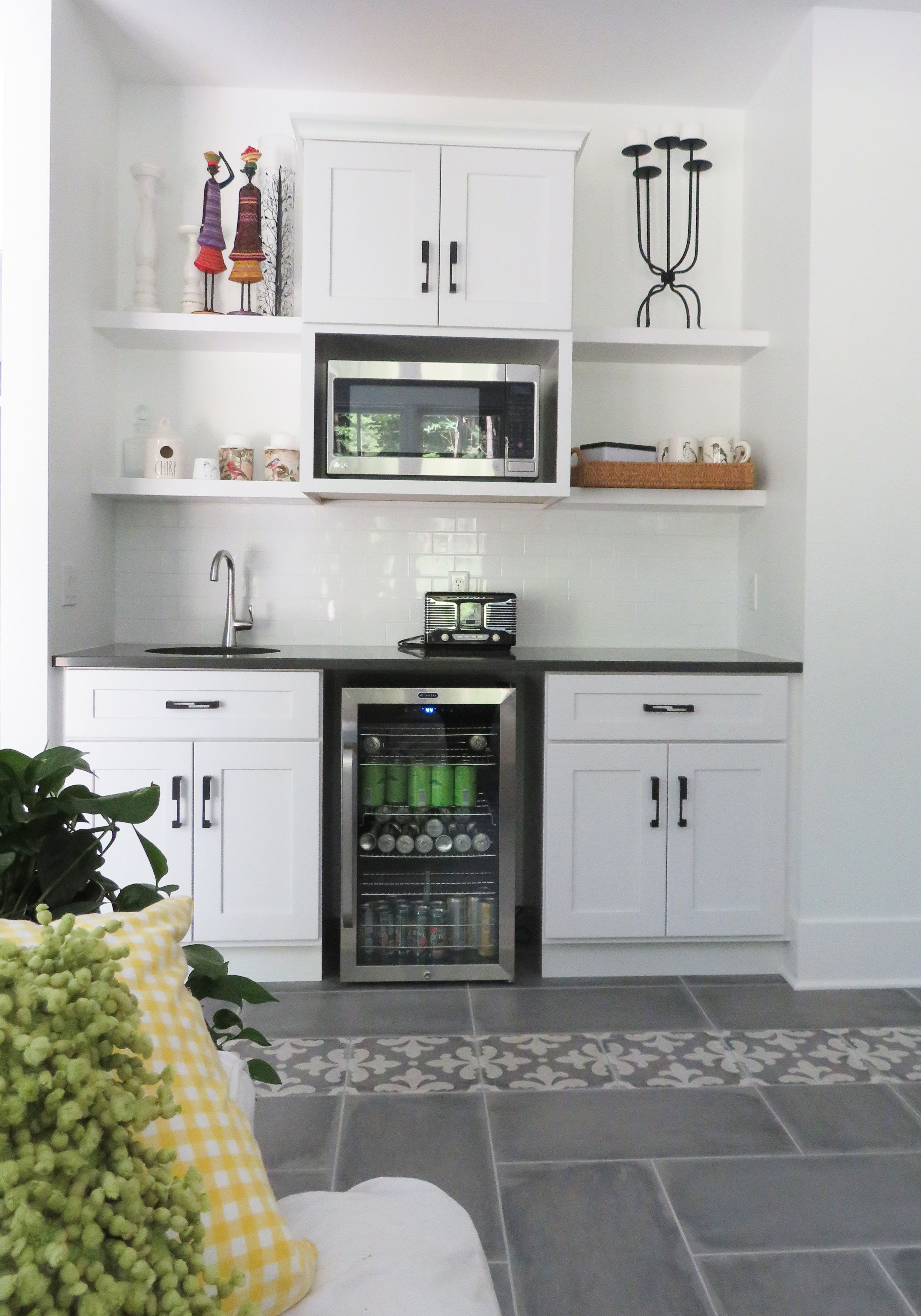 A Basement Wet Bar With Floating Shelves White Cabinetry And Quartz Countertops Kitchen And Bath Design Wet Bar Wet Bar Sink