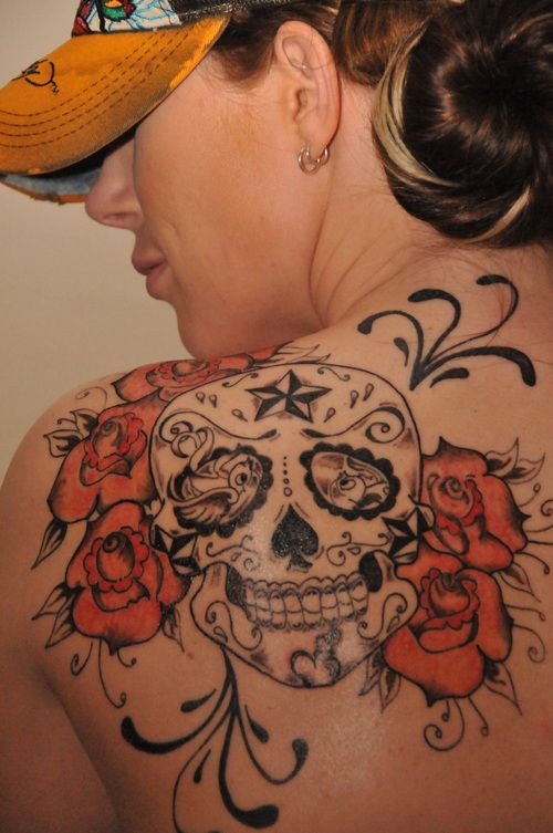 red and black sugar skull tattoo. I'd change the nautical star at the top.