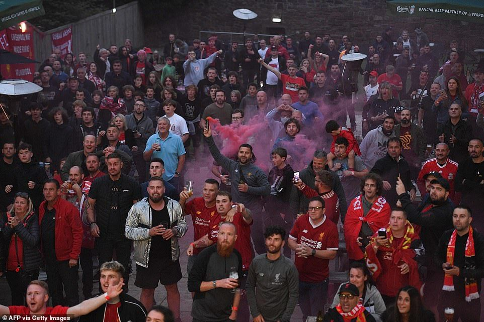 Liverpool fans celebrate as their side lift the premier