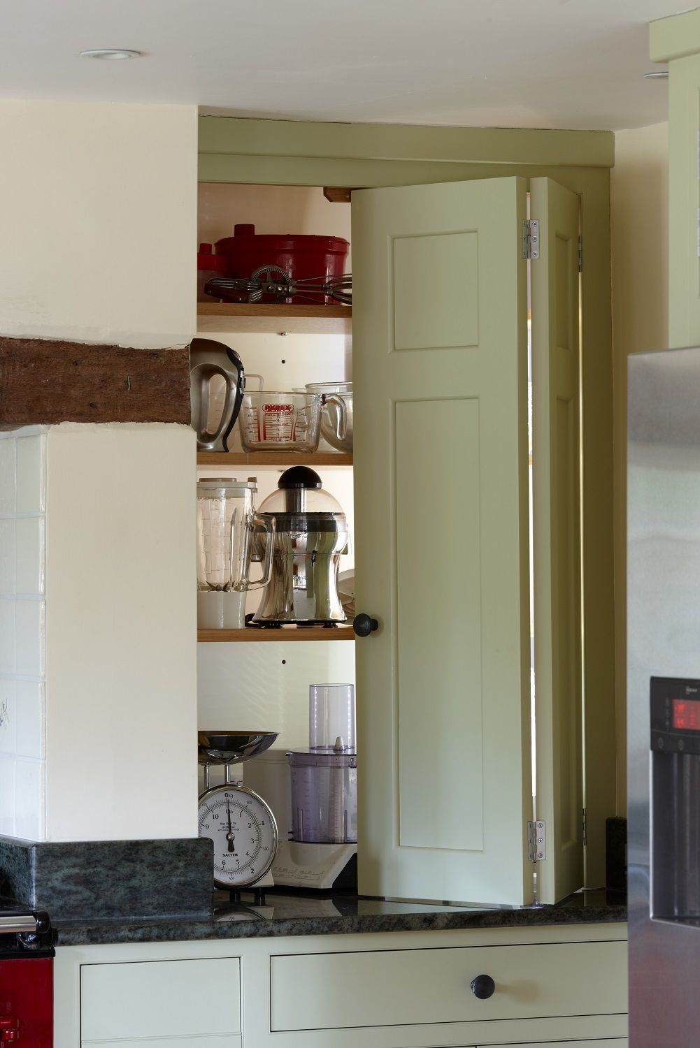 A smaller larder cupboard with bi fold doors for for Bi fold doors for kitchen cabinets