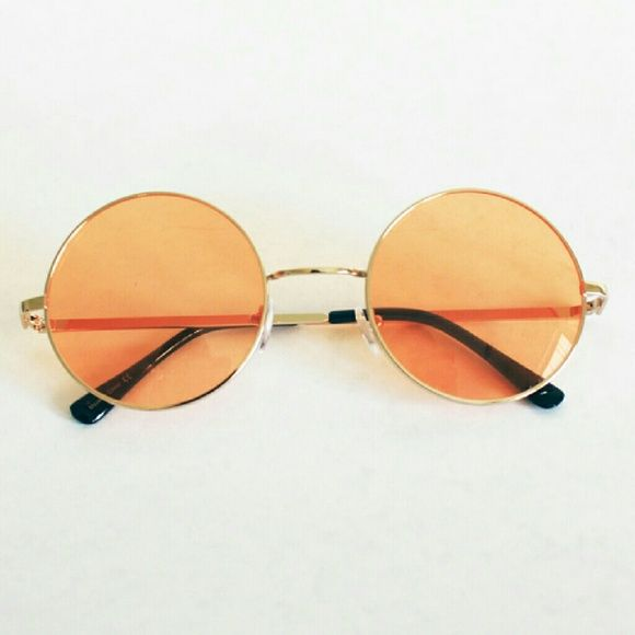 "Lennon round sunnies sunglasses - orange This listing is for a pair of round gold metal sunglasses with a pale orange lens. Lens diameter: 2"" Vera Lyndon  Accessories Sunglasses"