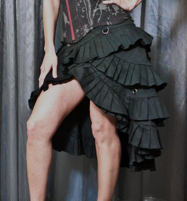 SkinGraft Ruffle Skirt  Code: DB-SG019    Skin.Graft is an emerging LA-based design house exploring the balance between raw underground fashion and sleek, high-end couture.    This is one of our top selling skirt due to its great style and extreme versatility! A little bit pirate, a little bit Victorian, very steampunk, and very fun! Adjustable at the waistband through a series of snaps. The top of the skirt can be worn at the waist or at the upper hip.    $198