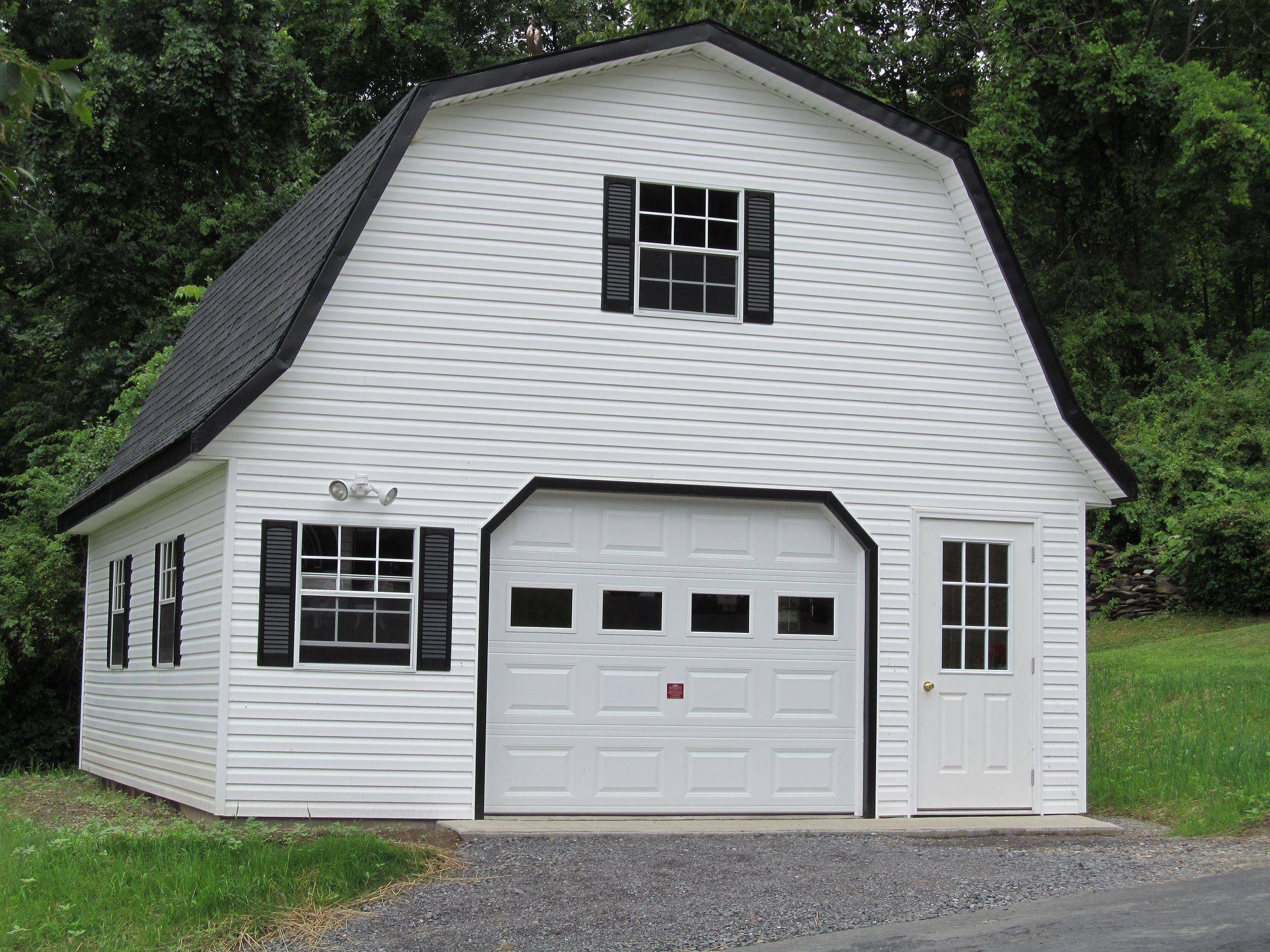 White vinyl siding on a gambrel garage garages for Gambrel home kits