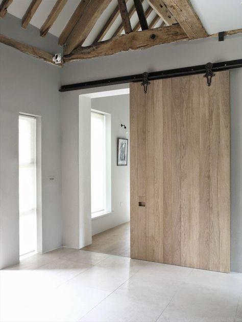schuifdeur tussen woonkamer en keuken gemaakt van stijgerhout ...