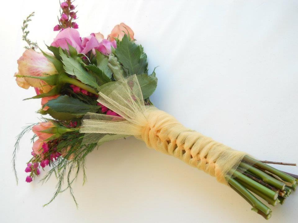 Pink and peach bridal bouquet with tulle wrapped stems