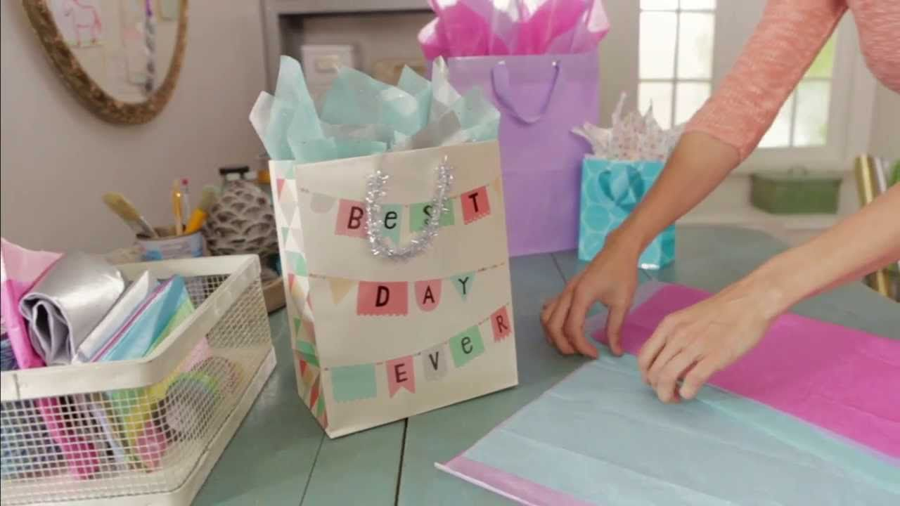 Helpful tips from hallmark for how to put tissue paper in