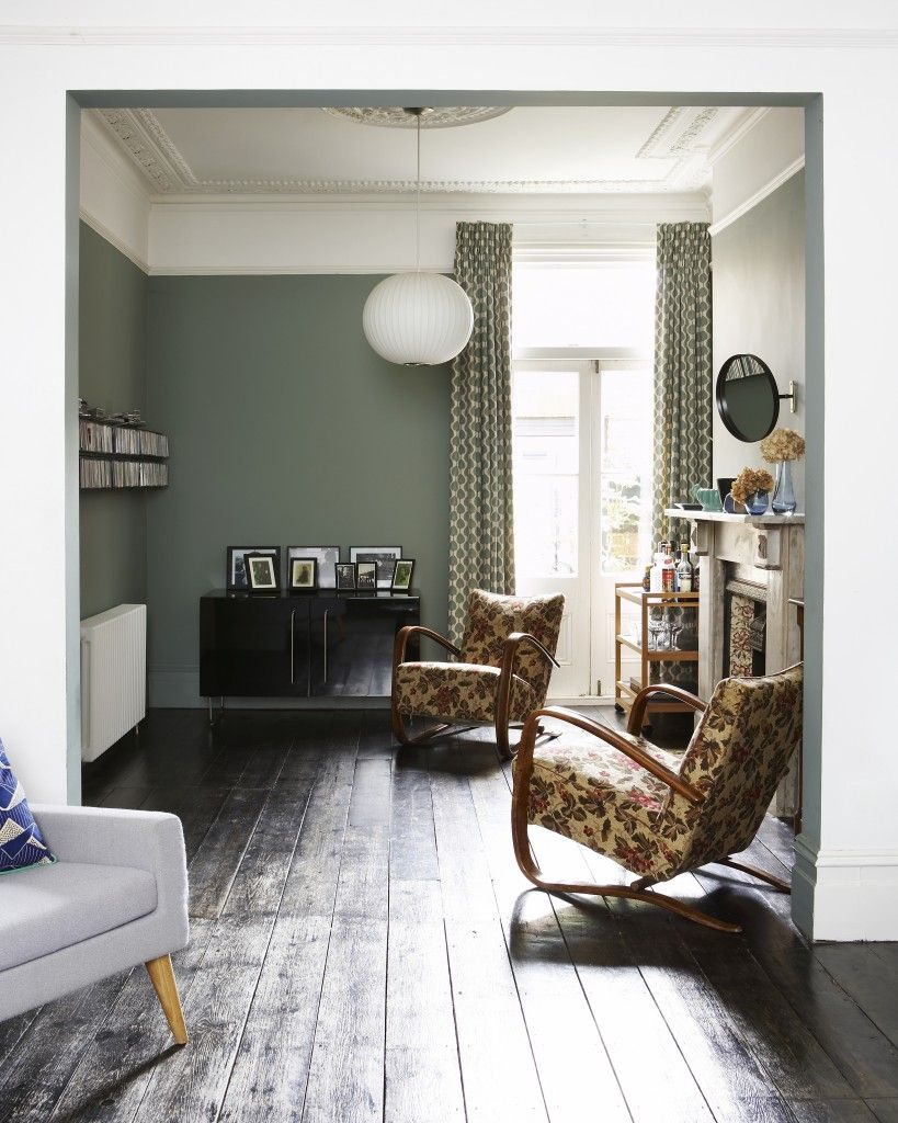 Green living room with modernist lamps. Design Bloggers at Home book ...