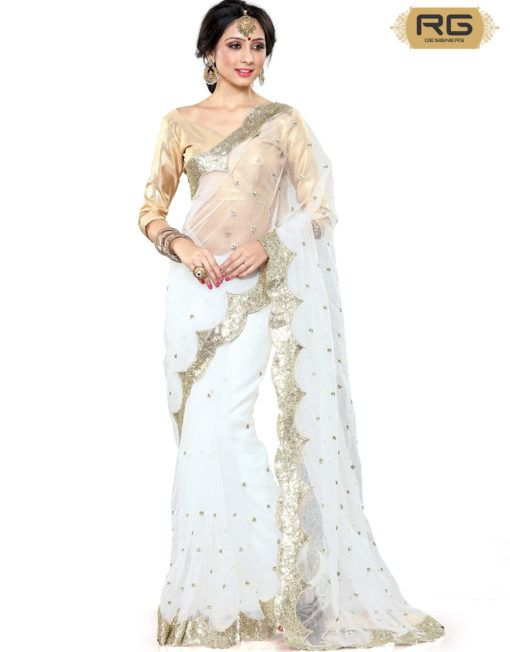19e77e6143 White Heavy Blouse Saree || Fairy white saree with gold embroidery and  border design teamed with gold blouse looks elegant. || RG Designers