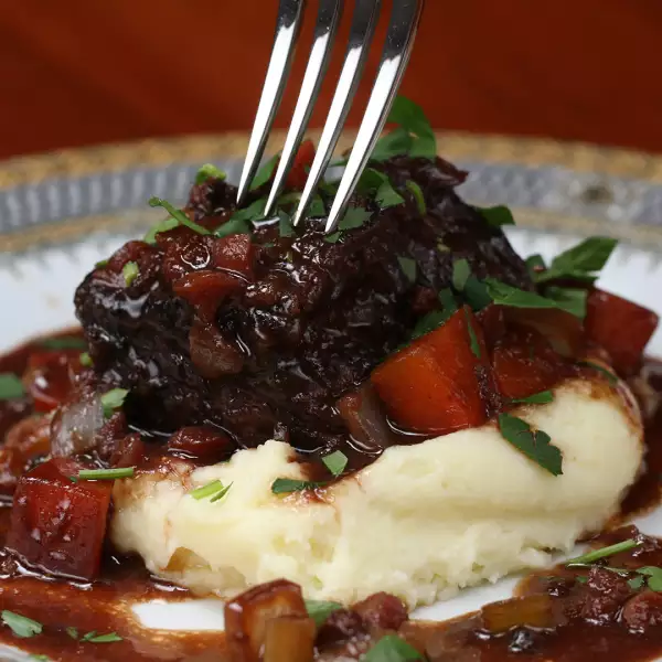 Red Wine Braised Short Ribs With Cashew Cauliflower Mash Recipe By Tasty Recipe Braised Short Ribs Recipe Braised Short Ribs Rib Recipes