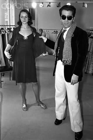 1972 - Karl Lagerfeld presenting a Chloé dress by Reginald Gray