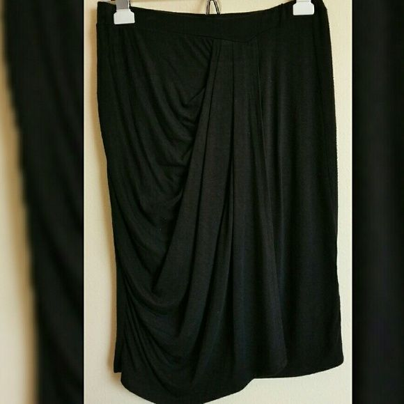 BLACK DRAPED SKIRT Size Small. Black. Draped front. Minimal pilling. Great condition. Knee length. 95% Rayon/5% Spandex. Loveappella Skirts
