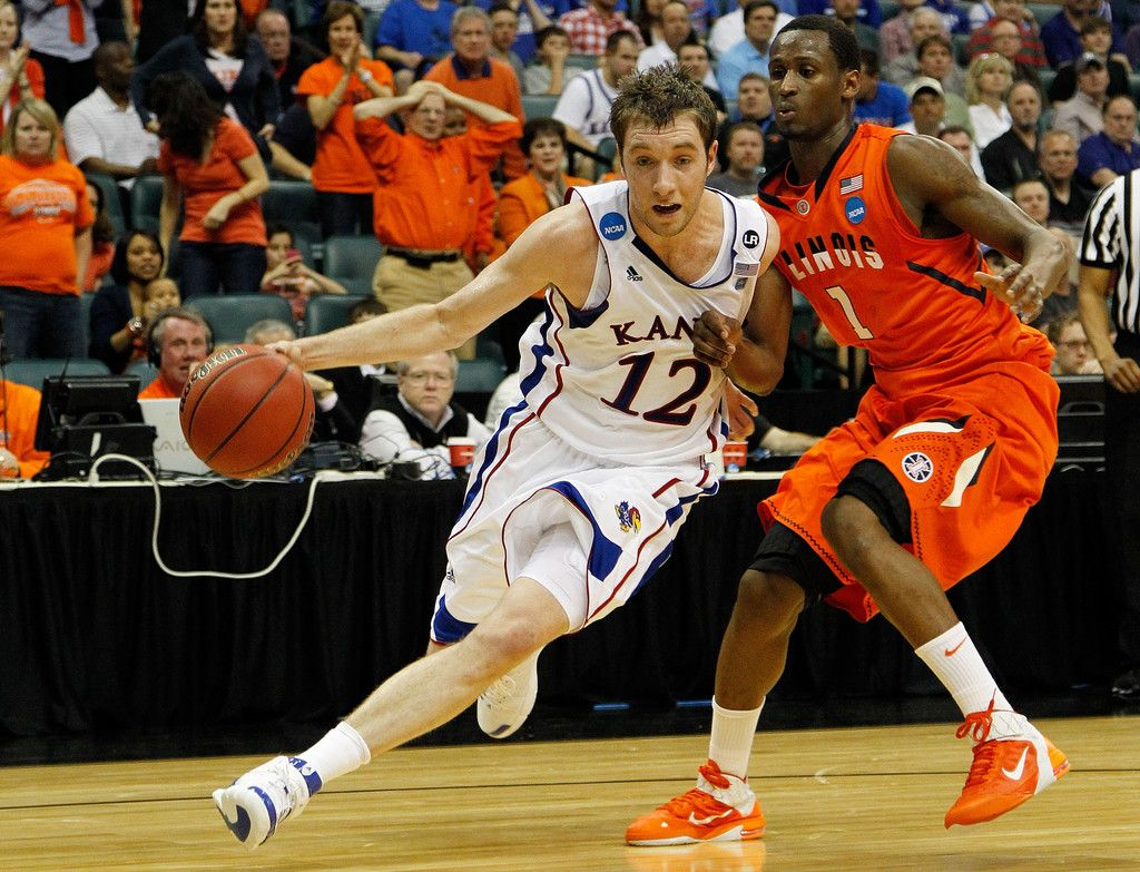 Brady Morningstar #12 of the Kansas Jayhawks drives with the ball against D.J. Richardson #1 of the Illinois Fighting Illini during the third round of the 2011 NCAA men's basketball tournament at BOK Center on March 20, 2011 in Tulsa, Oklahoma.  (March 19, 2011 - Source: Tom Pennington/Getty Images North America