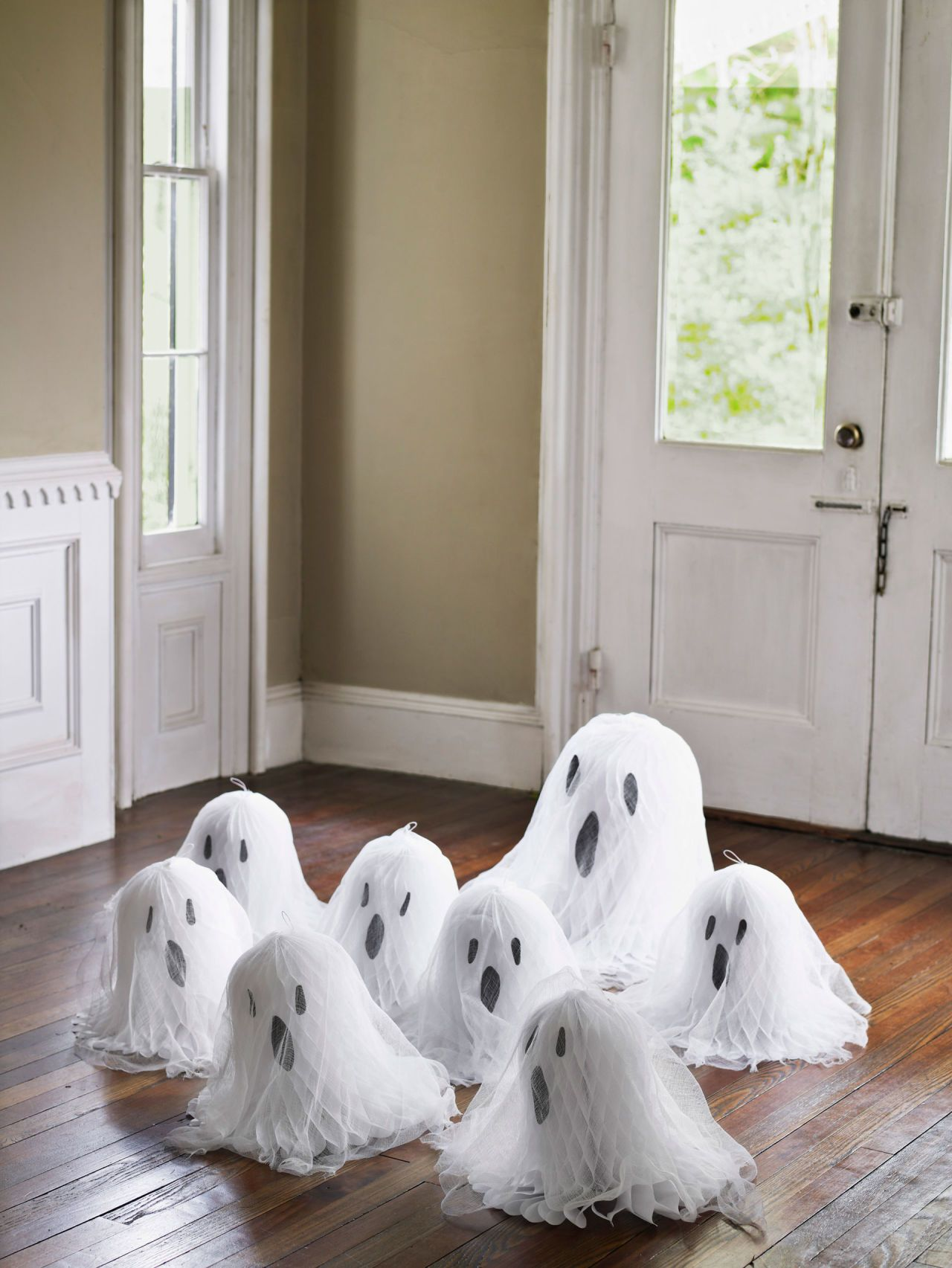 Greet Visitors with a Gaggle of Ghosts Tissue paper, Wedding bells - Inexpensive Halloween Decorations