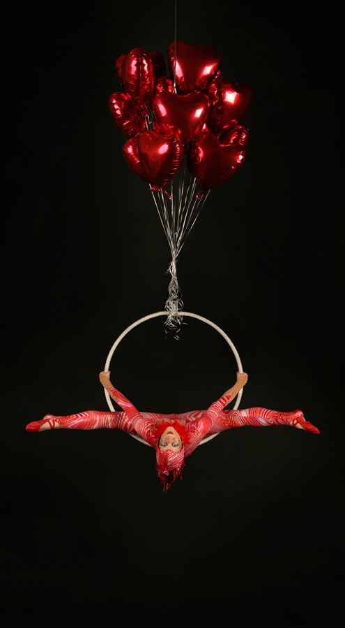 My new 'floating' aerial hoop act! Balloons of all colours and sizes available. The choice is yours!