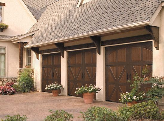 Charming Carriage House Garage Door With Wood Beam Over And Corbels