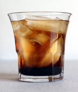 Black Russian – Mix That Drink  The Black Russian supposedly appeared in Brussels in 1949. It's a wonderfully simple cocktail – just vodka and Kahlua over ice. This is one of the easiest recipes for tinkering: try a different coffee liqueur, or a flavored vodka (vanilla is great), add a splash of cola, use equal amounts of vodka and liqueur, or you can even add a scoop of chocolate ice cream into this drink. This drink tastes enough like sweetened coffee that you can... #kahlua #vodka #simplecocktail
