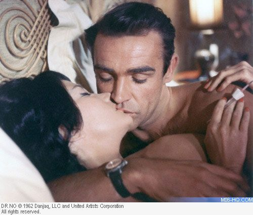 Bond Girl Villainess Miss Taro Sharing A Kiss In Her Bed W