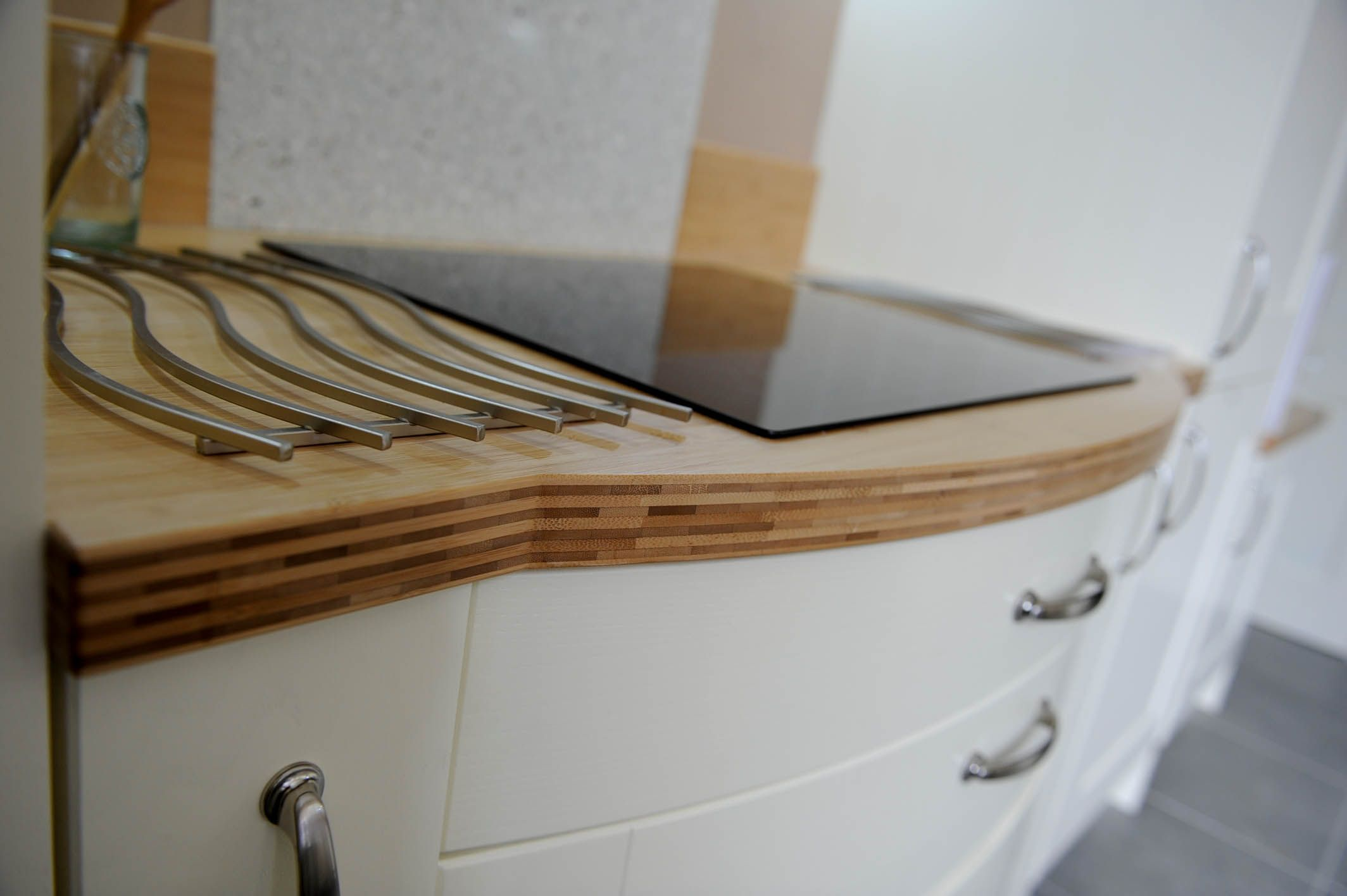 Lovely bowed drawers with a bamboo worktop via Sheffield