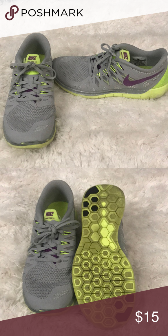 debeed9a5e82c Nike Sneakers Grey with purple and neon green accents. Nike run free 5.0.  Gently
