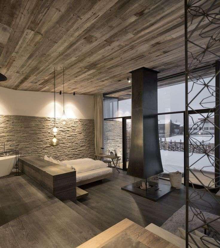 Decorare pareti interne in pietra - Soggiorno moderno con parete in ...