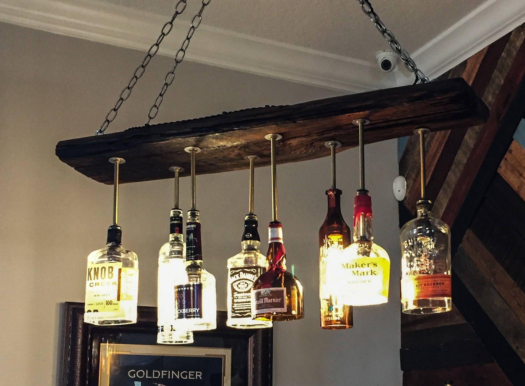 Lampadari Con Bottiglie Di Vetro liquor bottle chandelier bar - reclaimed wood (con immagini