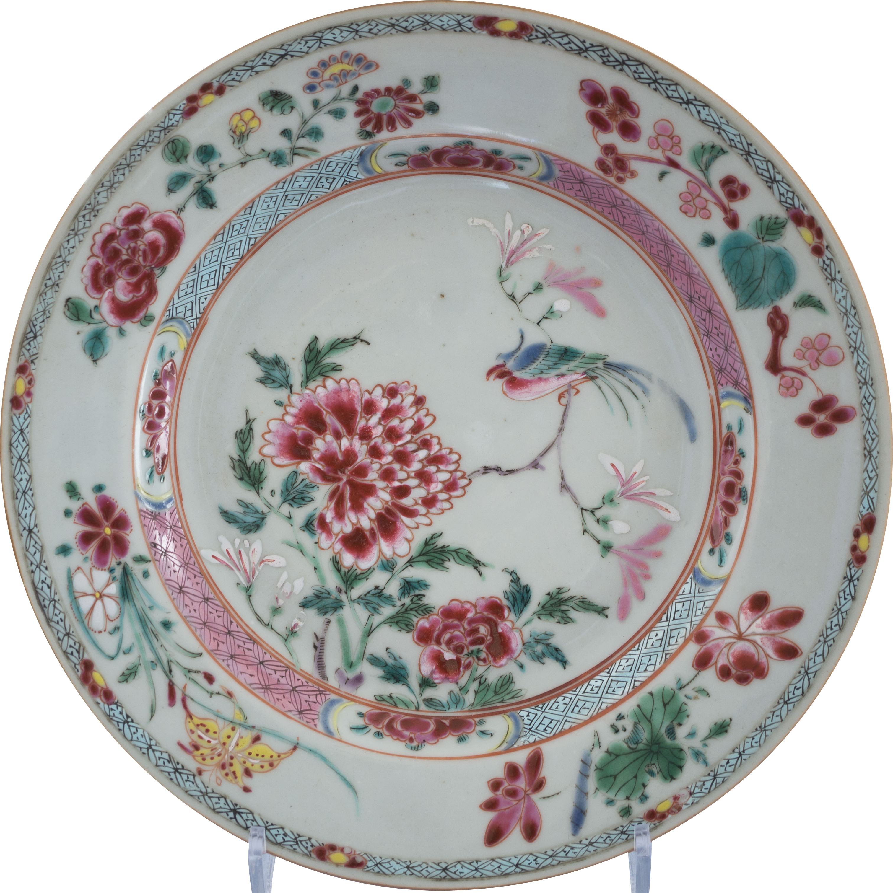 A Chinese export porcelain famille rose plate decorated with a bird. Yongzheng period. The center scene with a bird amongst peonies. On the rim, sprays of flowers.