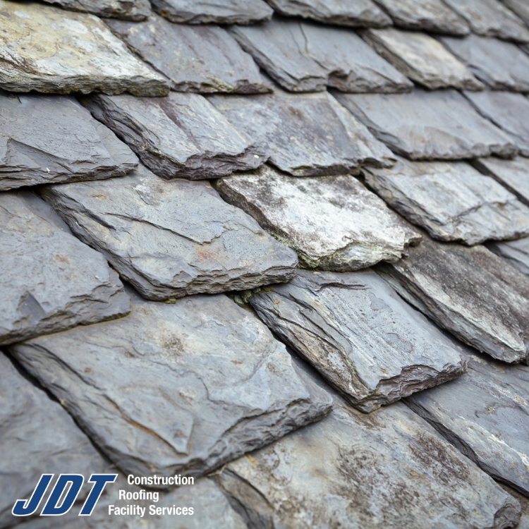 Slate Is One Of The Oldest Still Used Roofing Materials Dating Back Quite Some Time It Takes A Skilled Hand To Work Wi Slate Roof Roofing Contractors Roofing