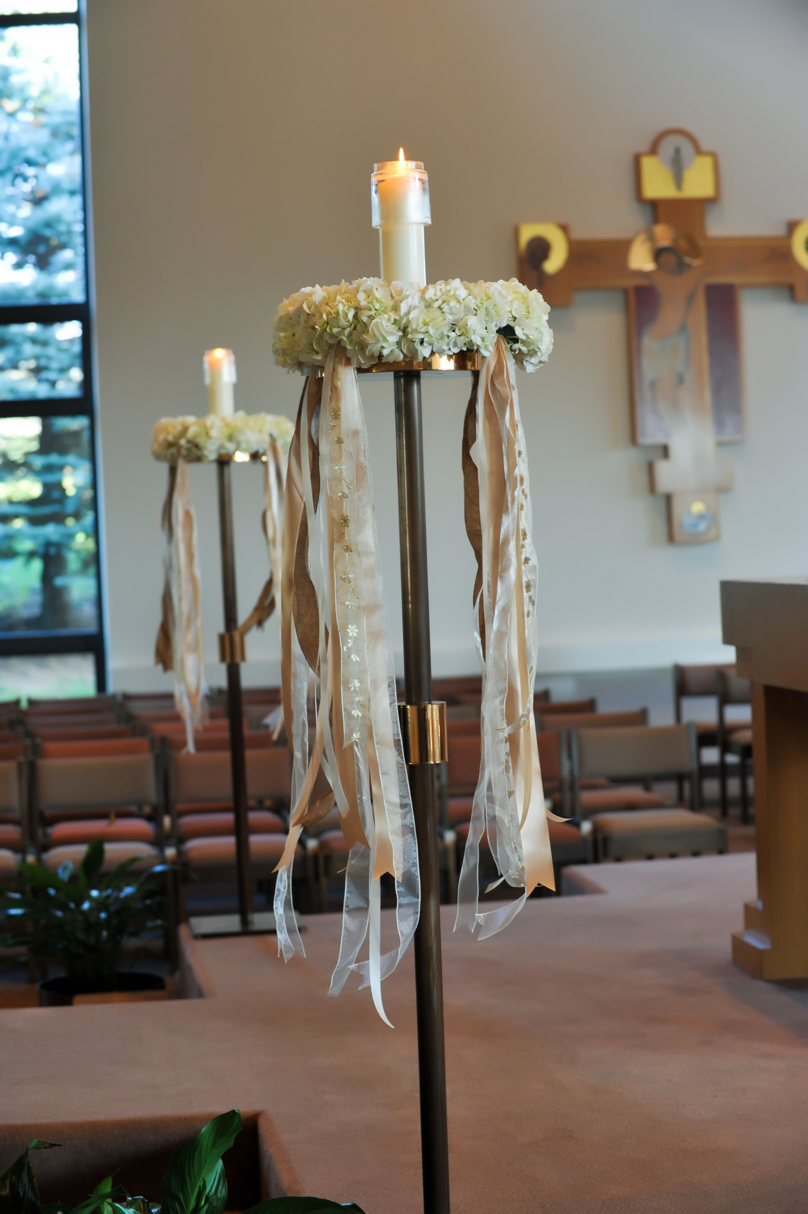 wreaths and ribbons that adorn the candles at church
