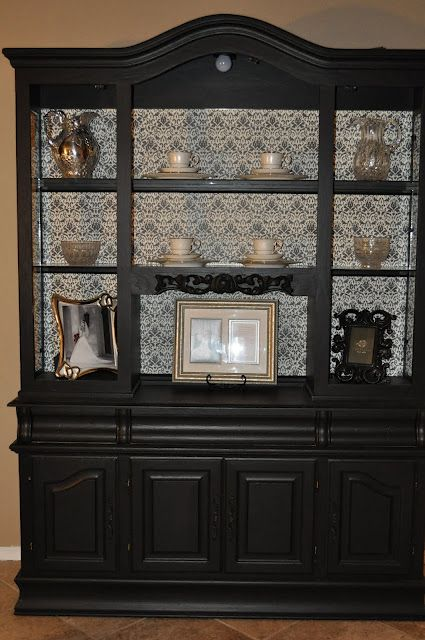 I think I will paint my china cabinet black with a light fabric or ...