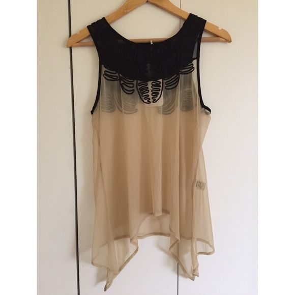 Brand new LF top with tags Never been worn brand new LF top with tags. The body of this top is sheer with black embroidered detailing around the neckline. Asymmetrical bottom! LF Tops Tank Tops