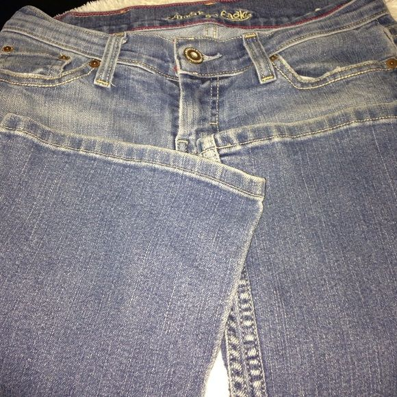 American Eagle boot cut size 4 short stretch Jeans American Eagle stretch boot cut size 4 short inseam 28  pre-loved still lots of life left in them very comfy jeans no flaws or stains in Great condition they were my favorite jeans they just don't fit me anymore my loss your gain American Eagle  Jeans Boot Cut