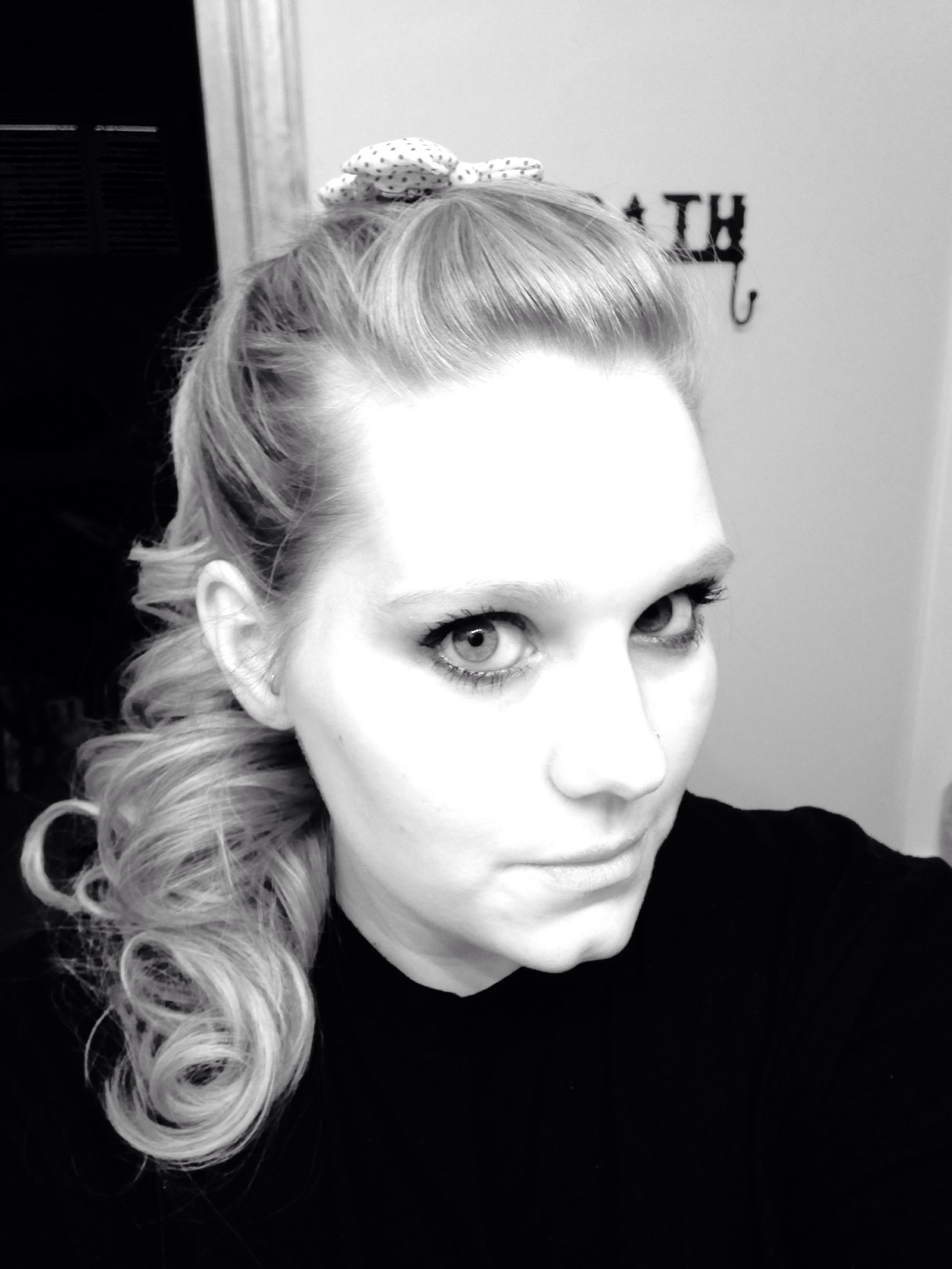 Curly pony tail with a small pompadour on top with polka dot bows ...