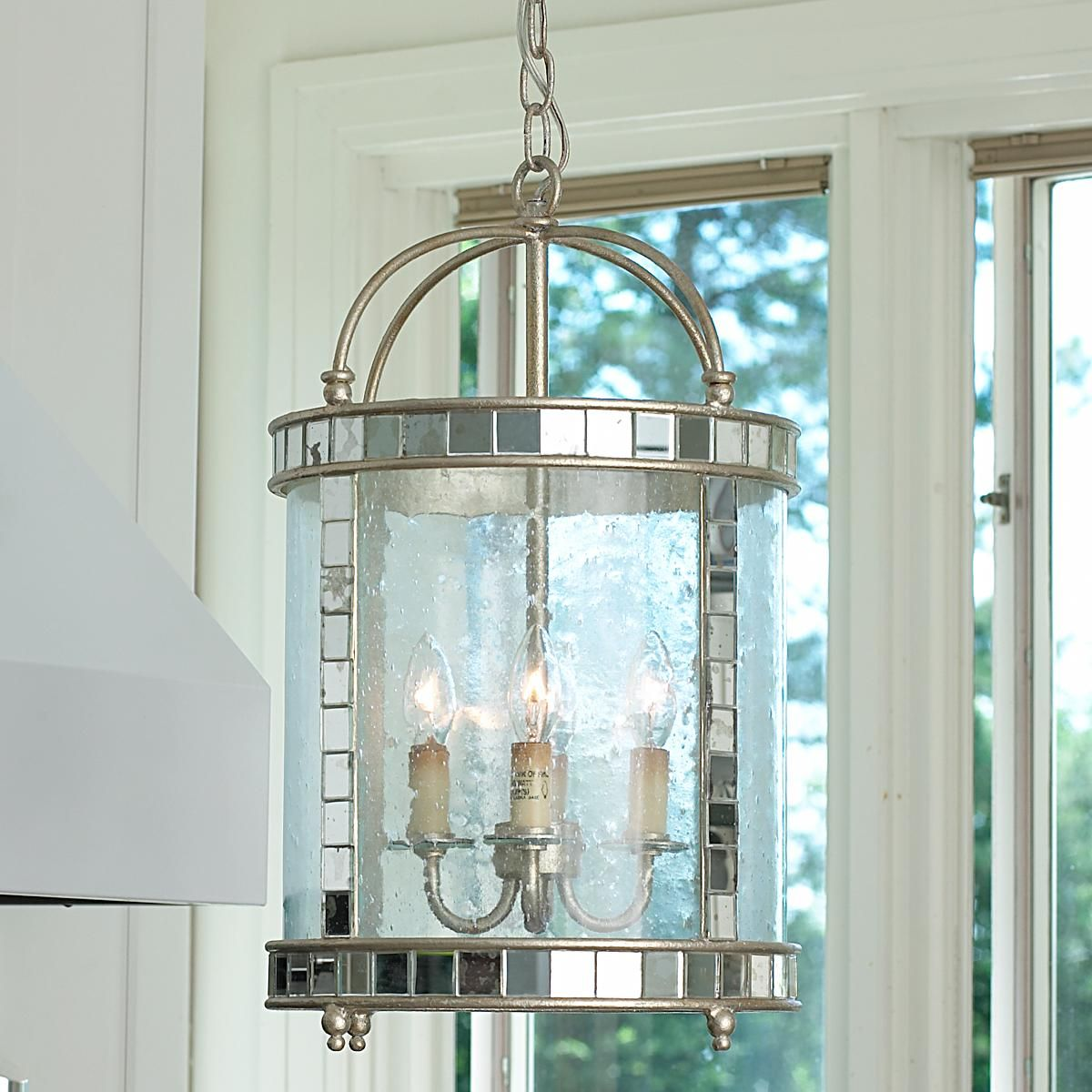 Mirror mosaic lantern glass and mirror make this light steal the