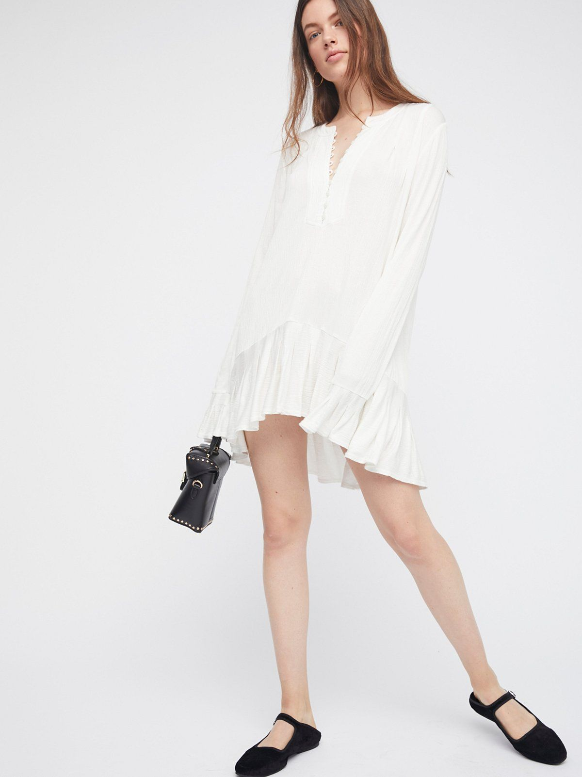 Your Girl Tunic   Soft and stretchy tunic in a crinkly fabrication featuring front button closures and a ruffled hem and sleeves cuffs.    * Semi-sheer