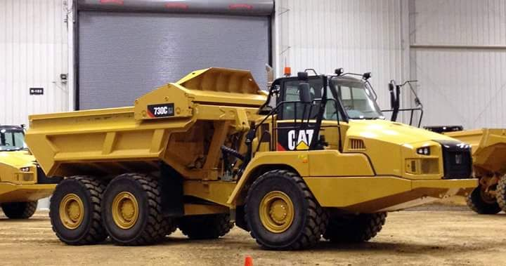 rollerman1 Cat 730C articulated haul truck with a push out dump - haul truck operator sample resume