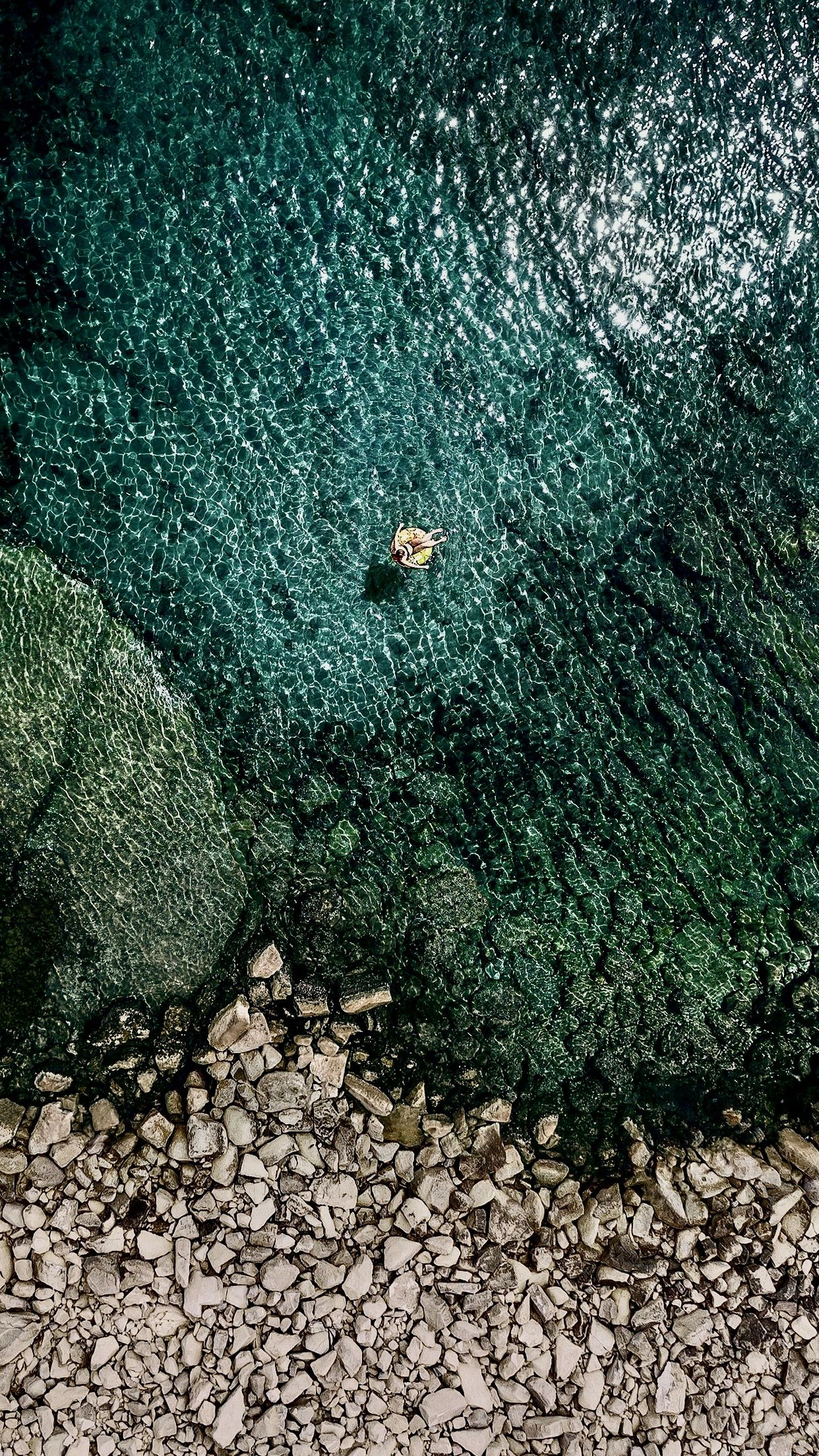Iphone 7 wallpaper iOS 10.3.3 beach stones.. in 2019 Ios
