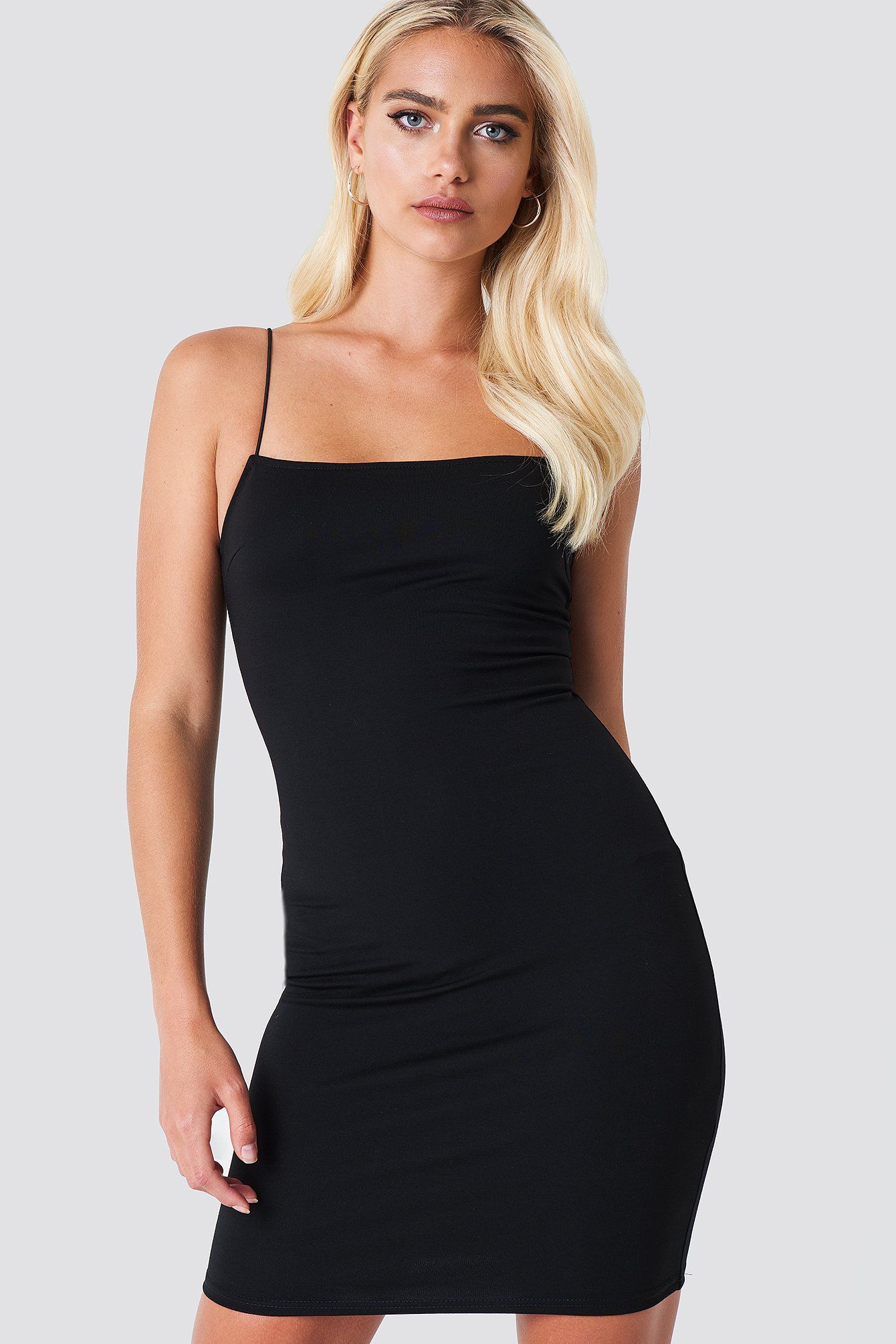 17f28a34d1 The Spaghetti Strap Dress by NA-KD features a tight fitted dress ...