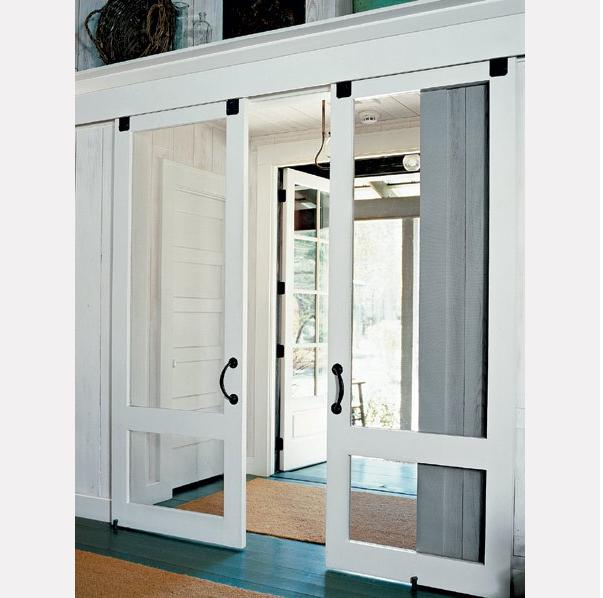 Barn Door Laundry Room | Wood frame doors with screening glide on ...